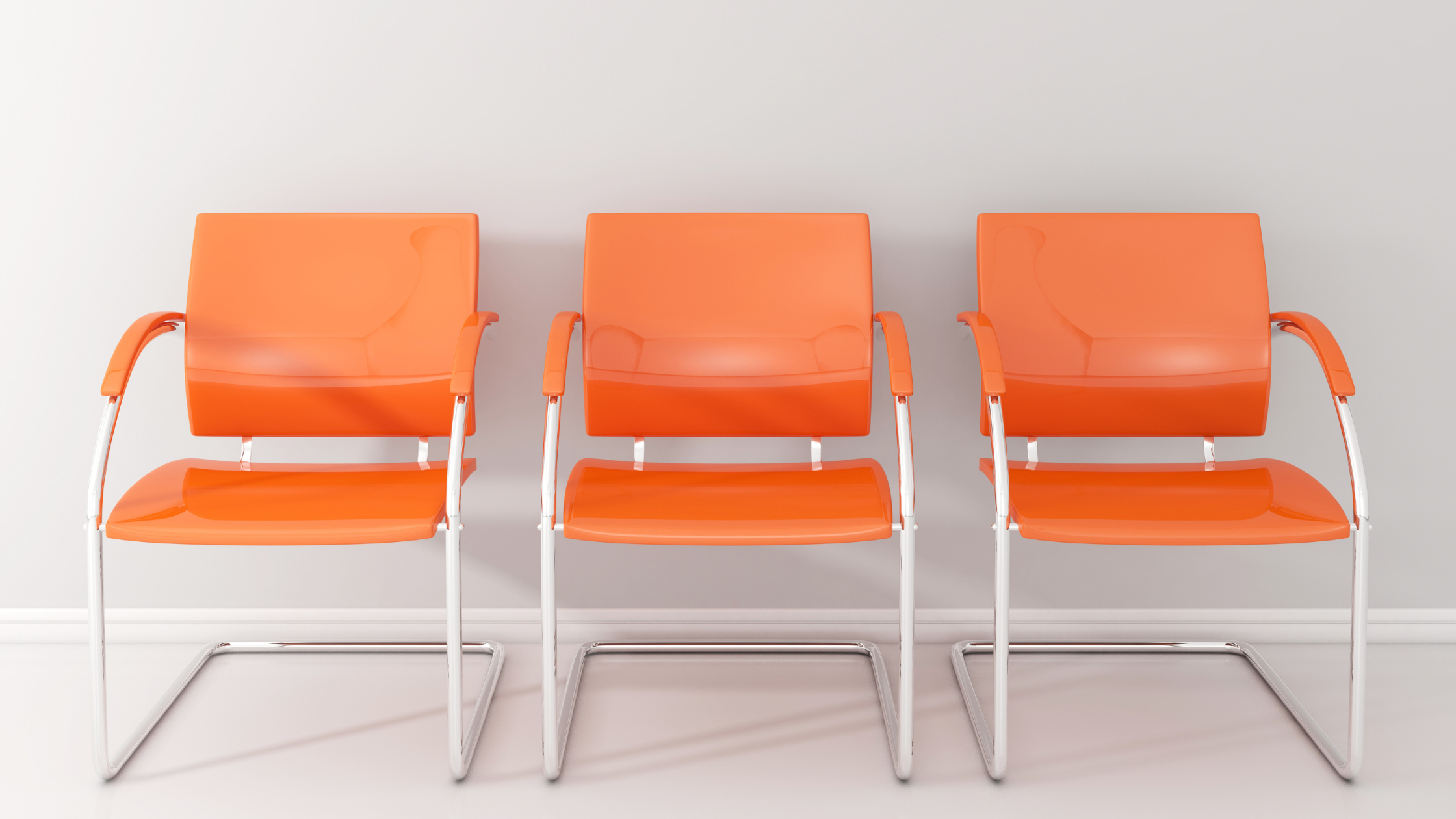 three orange chairs with white wall and white floor